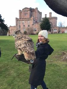Siberian Eagle Owl with Dalhousie Castle in the background